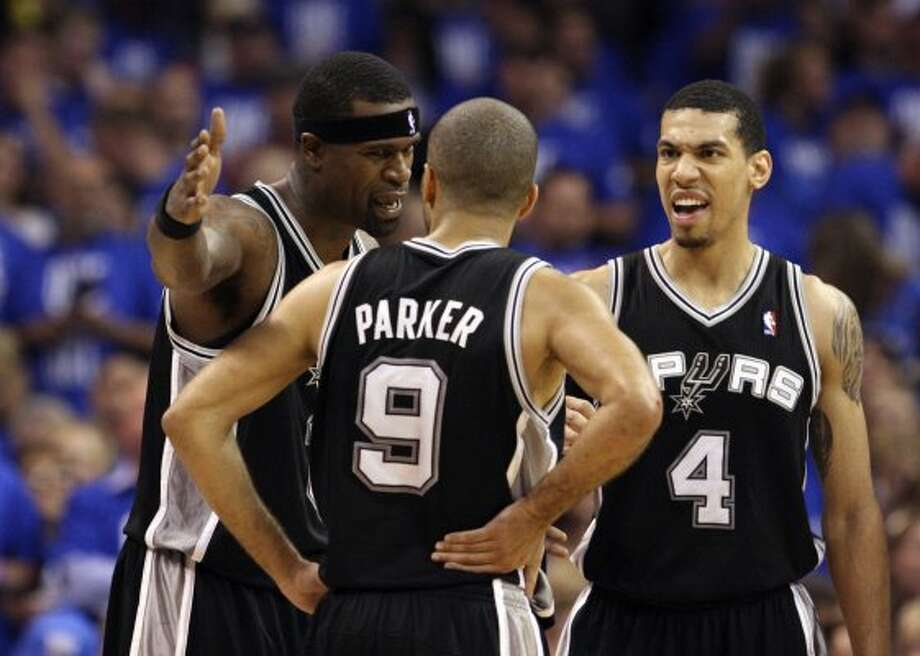 San Antonio Spurs' Stephen Jackson (3) talks to San Antonio Spurs' Tony Parker (9) as San Antonio Spurs' Danny Green (4) listens during the second half of game three of the NBA Western Conference Finals in Oklahoma City, Okla. on Thursday, May 31, 2012. (Edward A. Ornelas / Edward A. Ornelas / San Antonio Express-News)