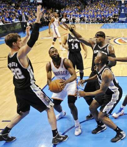 Thunder's James Harden looks for room between Spurs players during the second half of game three of the NBA Western Conference Finals in Oklahoma City, Okla. on Thursday, May 31, 2012.  The Thunder won 102-82. (Edward A. Ornelas / Edward A. Ornelas / San Antonio Express-News)