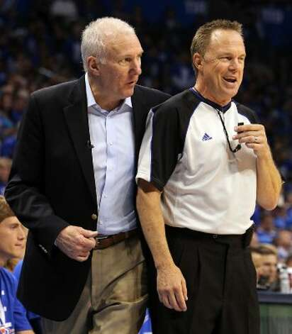 San Antonio Spurs coach Gregg Popovich walks around official Bill Spooner during the second half of game three of the NBA Western Conference Finals in Oklahoma City, Okla. on Thursday, May 31, 2012. (Kin Man Hui / Kin Man Hui / San Antonio Express-News)