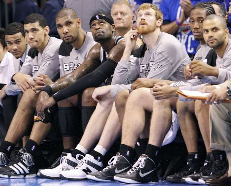 Members of the Spurs sit dejected on the bench near the end of game three of the NBA Western Conference Finals in Oklahoma City, Okla. on Thursday, May 31, 2012. The Thunder won 102-82. (Edward A. Ornelas / Edward A. Ornelas / San Antonio Express-News)