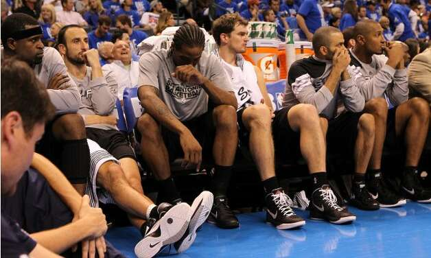 The Spurs bench late in the game during the second half of game three of the NBA Western Conference Finals in Oklahoma City, Okla. on Thursday, May 31, 2012.  The Thunder won 102-82. (Kin Man Hui / Kin Man Hui / San Antonio Express-News)