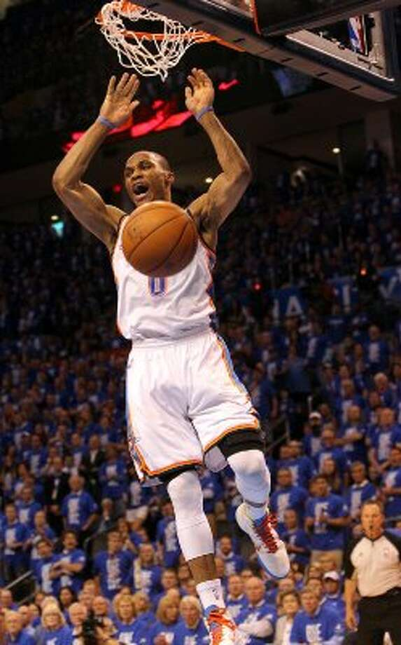 Oklahoma City Thunder's Russell Westbrook (0) dunks during the second half of game three of the NBA Western Conference Finals in Oklahoma City, Okla. on Thursday, May 31, 2012.  The Thunder won 102-82. (Kin Man Hui / Kin Man Hui / San Antonio Express-News)