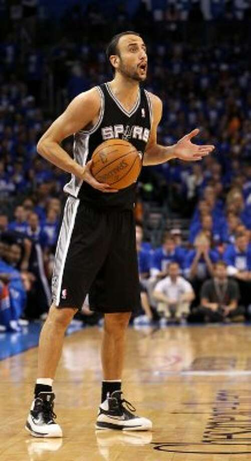 San Antonio Spurs' Manu Ginobili (20) gestures during the first half of game three of the NBA Western Conference Finals in Oklahoma City, Okla. on Thursday, May 31, 2012. (Kin Man Hui / Kin Man Hui / San Antonio Express-News)