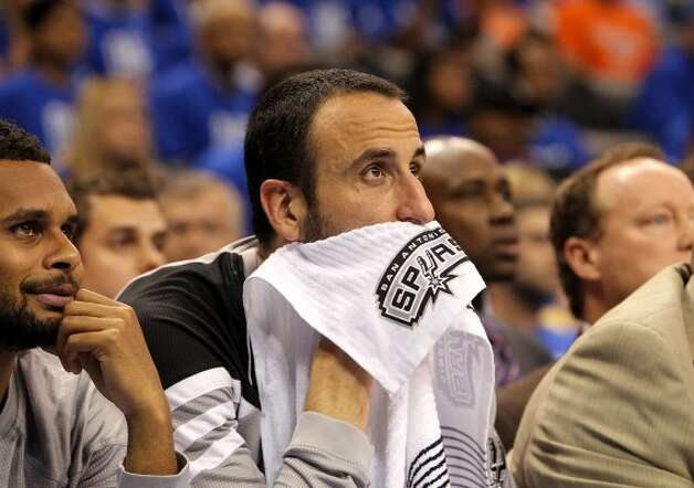 San Antonio Spurs' Manu Ginobili (20) looks on from the bench during the first half of game three of the NBA Western Conference Finals in Oklahoma City, Okla. on Thursday, May 31, 2012. (Kin Man Hui / Kin Man Hui / San Antonio Express-News)