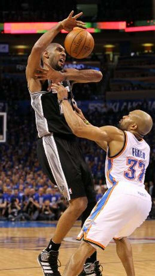 San Antonio Spurs' Tim Duncan (21) loses control of the ball against Oklahoma City Thunder's Derek Fisher (37) during the first half of game three of the NBA Western Conference Finals in Oklahoma City, Okla. on Thursday, May 31, 2012. (Kin Man Hui / Kin Man Hui / San Antonio Express-News)