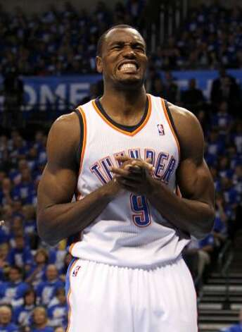 Oklahoma City Thunder's Serge Ibaka (9) grimaces after a play during the first half of game three of the NBA Western Conference Finals in Oklahoma City, Okla. on Thursday, May 31, 2012. (Kin Man Hui / Kin Man Hui / San Antonio Express-News)