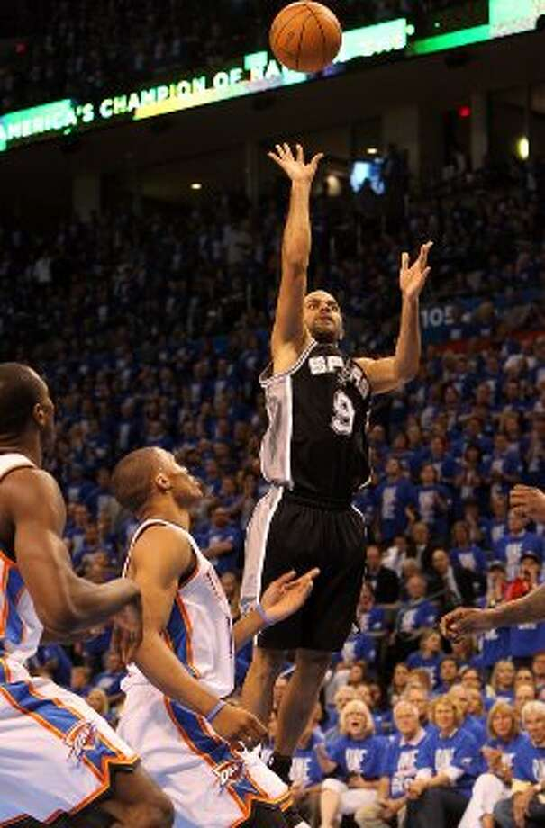 San Antonio Spurs' Tony Parker (9) shoots over Oklahoma City Thunder's Russell Westbrook (0) during the first half of game three of the NBA Western Conference Finals in Oklahoma City, Okla. on Thursday, May 31, 2012. (Kin Man Hui / Kin Man Hui / San Antonio Express-News)