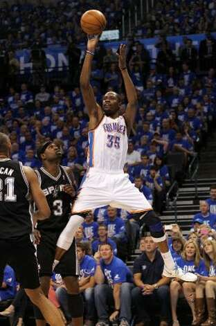 Oklahoma City Thunder's Kevin Durant (35) shoots over San Antonio Spurs' Stephen Jackson (3) during the second half of game three of the NBA Western Conference Finals in Oklahoma City, Okla. on Thursday, May 31, 2012. (Kin Man Hui / Kin Man Hui / San Antonio Express-News)