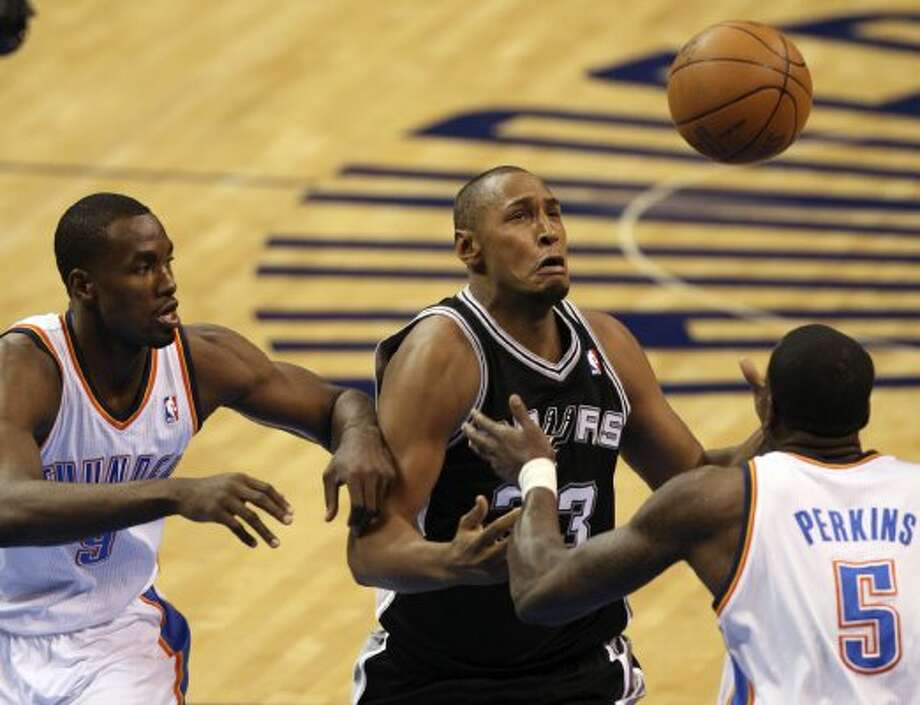 San Antonio Spurs' Boris Diaw (33) loses control of the ball against Oklahoma City Thunder's Serge Ibaka (9) and Oklahoma City Thunder's Kendrick Perkins (5) during the first half of game three of the NBA Western Conference Finals in Oklahoma City, Okla. on Thursday, May 31, 2012. (Kevin Martin / Kevin Martin / San Antonio Express-News)