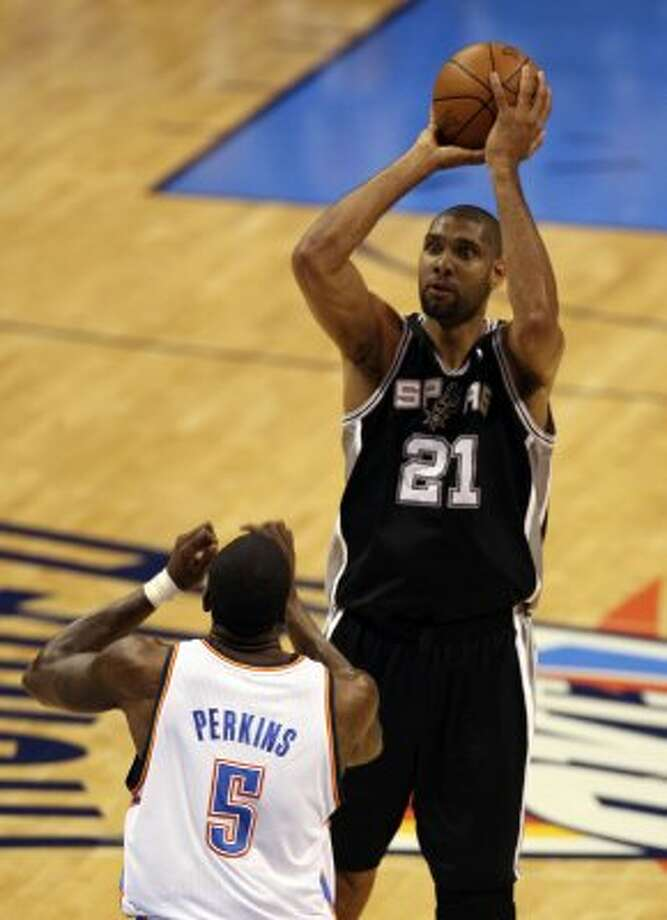 San Antonio Spurs' Tim Duncan (21) shoots over Oklahoma City Thunder's Kendrick Perkins (5) during the first half of game three of the NBA Western Conference Finals in Oklahoma City, Okla. on Thursday, May 31, 2012. (Kevin Martin / Kevin Martin / San Antonio Express-News)