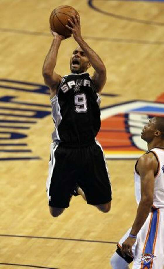 San Antonio Spurs' Tony Parker (9) shoots near Oklahoma City Thunder's Russell Westbrook (0) during the first half of game three of the NBA Western Conference Finals in Oklahoma City, Okla. on Thursday, May 31, 2012. (Kevin Martin / Kevin Martin / San Antonio Express-News)