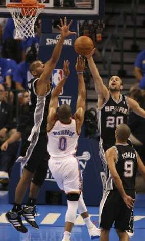 San Antonio Spurs' Manu Ginobili (20) blocks a shot by Oklahoma City Thunder's Russell Westbrook (0) near San Antonio Spurs' Tim Duncan (21) during the first half of game three of the NBA Western Conference Finals in Oklahoma City, Okla. on Thursday, May 31, 2012. (Kevin Martin / Kevin Martin / San Antonio Express-News)