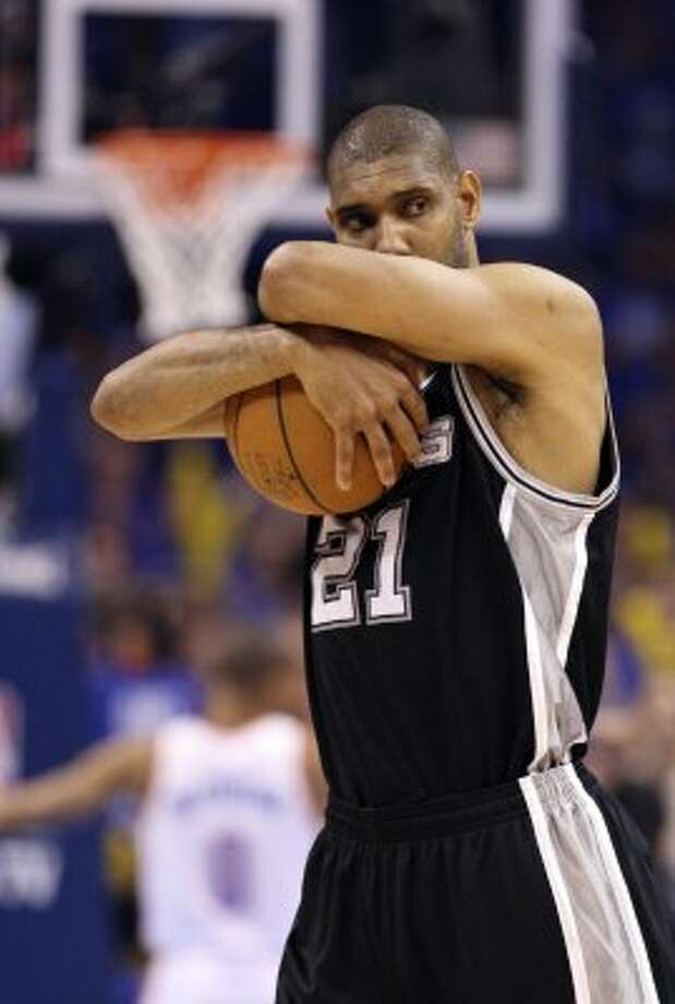 San Antonio Spurs' Tim Duncan (21) holds on to the ball before the first half of game three of the NBA Western Conference Finals in Oklahoma City, Okla. on Thursday, May 31, 2012. (Edward A. Ornelas / Edward A. Ornelas / San Antonio Express-News)