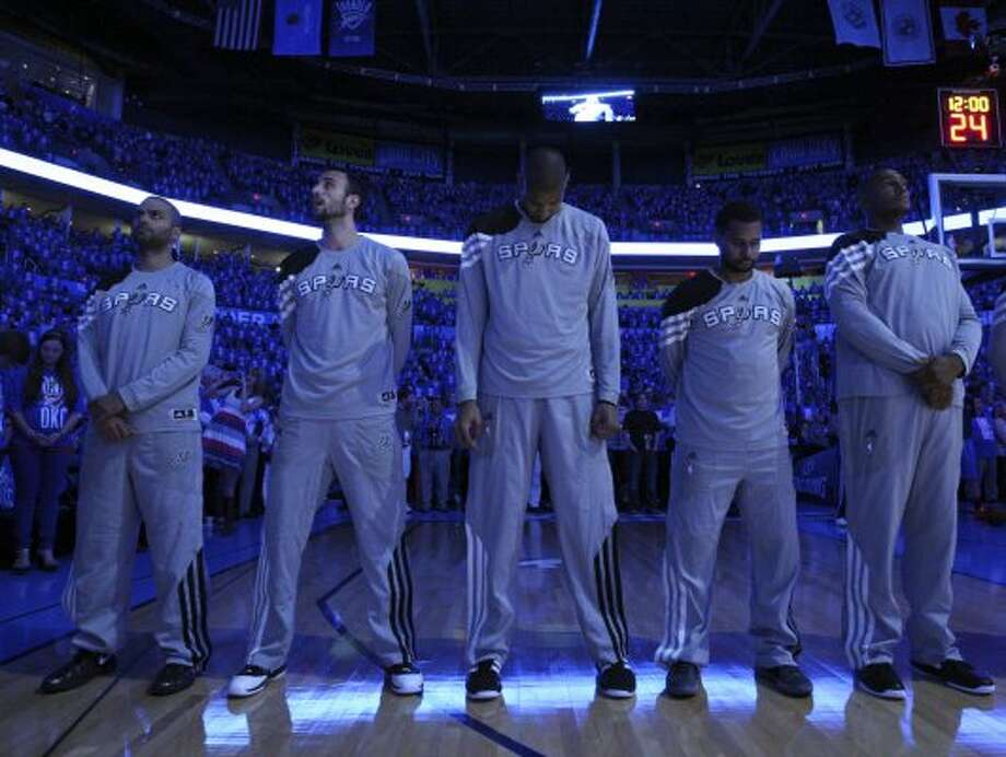 Spurs players during the National Anthem before the first half of game three of the NBA Western Conference Finals in Oklahoma City, Okla. on Thursday, May 31, 2012. (Edward A. Ornelas / Edward A. Ornelas / San Antonio Express-News)