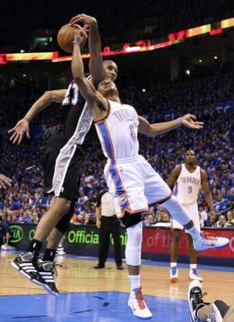 San Antonio Spurs' Tim Duncan (21) blocks a shot by Oklahoma City Thunder's Russell Westbrook (0) during the first half of game three of the NBA Western Conference Finals in Oklahoma City, Okla. on Thursday, May 31, 2012. (Edward A. Ornelas / Edward A. Ornelas / San Antonio Express-News)