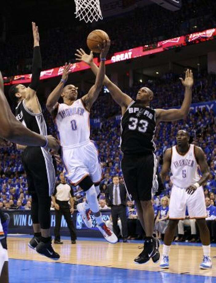 Oklahoma City Thunder's Russell Westbrook (0) shoots against San Antonio Spurs' Danny Green (4) and San Antonio Spurs' Boris Diaw (33) during the first half of game three of the NBA Western Conference Finals in Oklahoma City, Okla. on Thursday, May 31, 2012. (Edward A. Ornelas / Edward A. Ornelas / San Antonio Express-News)