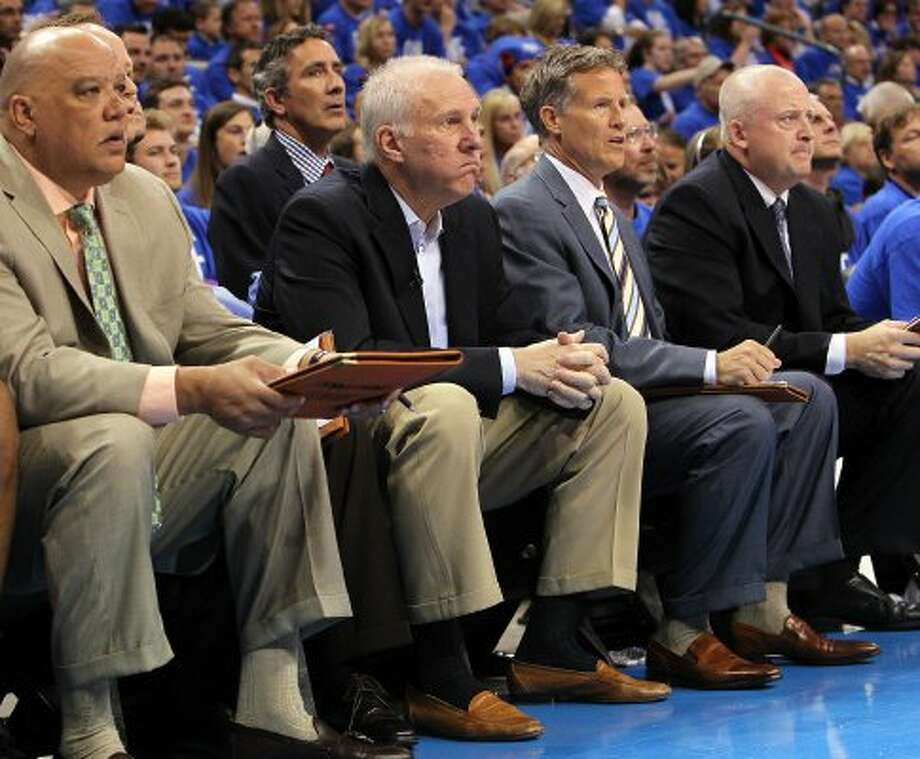 San Antonio Spurs coach Gregg Popovich, center, sits on the bench during the first half of game three of the NBA Western Conference Finals in Oklahoma City, Okla. on Thursday, May 31, 2012. (Kin Man Hui / Kin Man Hui / San Antonio Express-News)