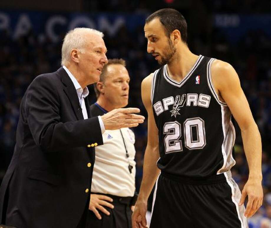 San Antonio Spurs coach Gregg Popovich talks to San Antonio Spurs' Manu Ginobili (20) during the first half of game three of the NBA Western Conference Finals in Oklahoma City, Okla. on Thursday, May 31, 2012. (Kin Man Hui / Kin Man Hui / San Antonio Express-News)