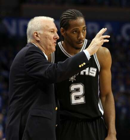 San Antonio Spurs coach Gregg Popovich talks to San Antonio Spurs' Kawhi Leonard (2) during the first half of game three of the NBA Western Conference Finals in Oklahoma City, Okla. on Thursday, May 31, 2012. (Kin Man Hui / Kin Man Hui / San Antonio Express-News)