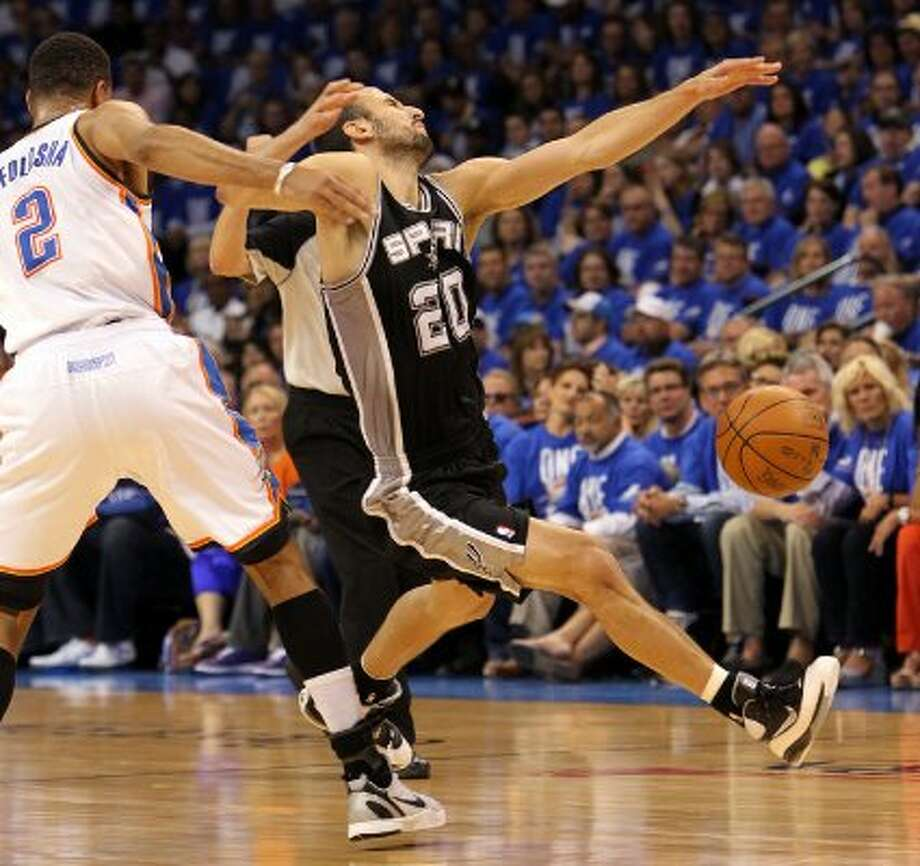 San Antonio Spurs' Manu Ginobili (20) is fouled by Oklahoma City Thunder's Thabo Sefolosha (2) during the first half of game three of the NBA Western Conference Finals in Oklahoma City, Okla. on Thursday, May 31, 2012. (Kin Man Hui / Kin Man Hui / San Antonio Express-News)