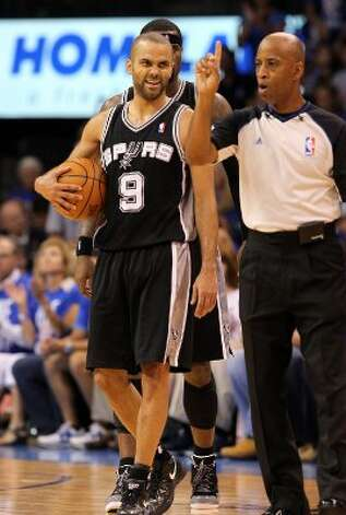 San Antonio Spurs' Tony Parker (9) reacts after being call for a foul during the first half of game three of the NBA Western Conference Finals in Oklahoma City, Okla. on Thursday, May 31, 2012. (Kin Man Hui / Kin Man Hui / San Antonio Express-News)