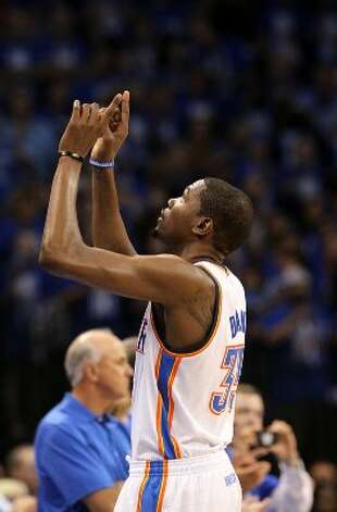 Oklahoma City Thunder's Kevin Durant (35) motions upward during the first half of game three of the NBA Western Conference Finals in Oklahoma City, Okla. on Thursday, May 31, 2012. (Kin Man Hui / Kin Man Hui / San Antonio Express-News)