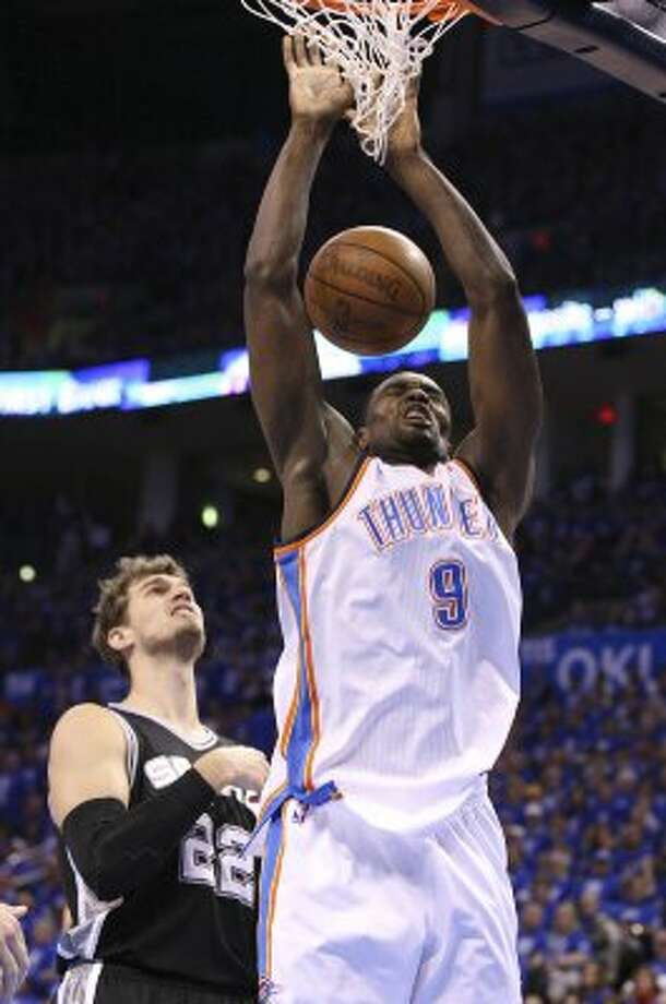 Oklahoma City Thunder's Serge Ibaka (9) dunks in front of San Antonio Spurs' Tiago Splitter (22) during the first half of game three of the NBA Western Conference Finals in Oklahoma City, Okla. on Thursday, May 31, 2012. (Edward A. Ornelas / Edward A. Ornelas / San Antonio Express-News)