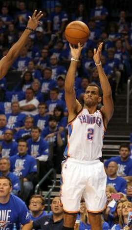Oklahoma City Thunder's Thabo Sefolosha (2) shoots the ball during the second half of game three of the NBA Western Conference Finals in Oklahoma City, Okla. on Thursday, May 31, 2012. (Kin Man Hui / Kin Man Hui / San Antonio Express-News)