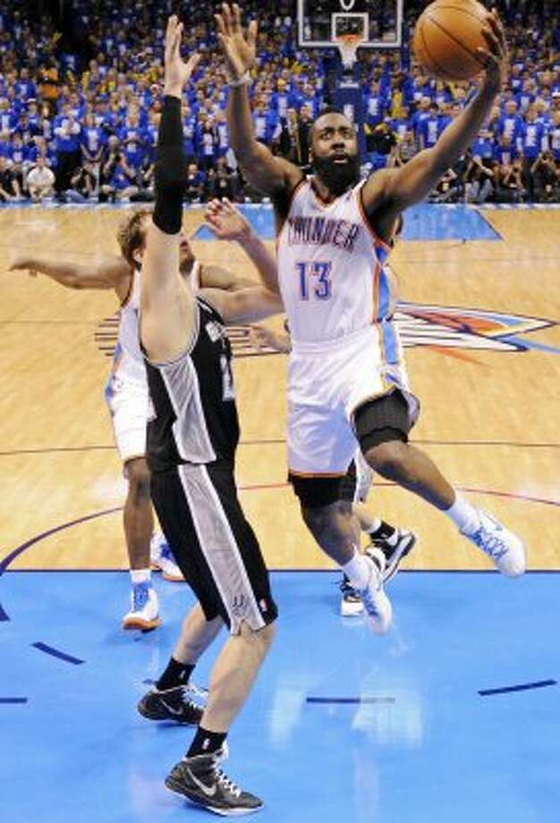 Thunder's James Harden shoots around Spurs' Tiago Splitter during the second half of game three of the NBA Western Conference Finals in Oklahoma City, Okla. on Thursday, May 31, 2012.  The Thunder won 102-82. (Edward A. Ornelas / Edward A. Ornelas / San Antonio Express-News)