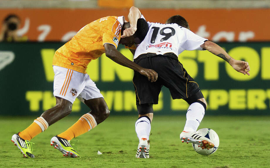 Houston Dynamo defender Warren Creavalle (5) gets tangles with Valencia midfielder Pablo Hernandez (19) during second half of the BBVA Compass Dynamo Charities Cup friendly soccer match on Thursday, May 31, 2012, at BBVA Compass Stadium in Houston. Valencia won the game 2-1. Photo: Smiley N. Pool, Houston Chronicle / © 2012  Houston Chronicle