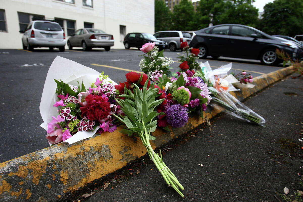 Flowers are shown near Town Hall where Gloria Leonidas was killed during a series of shootings in Seattle. Six people died during the day of violence. Photographed on Thursday, May 31, 2012.