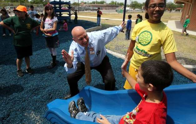 Harlandale ISD Superintendent Robert Jaklich (center) high-fives students at Adams Elementary School on May 4, 2011. The district, under Jaklich, has been ranked No. 1 in San Antonio and fourth in the state based on academic performance and amount of dollars spent. (John Davenport / San Antonio Express-News) Photo: File Photo, San Antonio Express-News