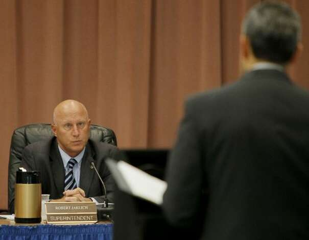 Harlandale ISD Superintendent Robert Jaklich (left) listens to Richard Hernandez, assistant superintendent of business, during a board meeting on Aug. 22, 2011, at Rayburn Elementary School. (Darren Abate / For to the Express-News)
