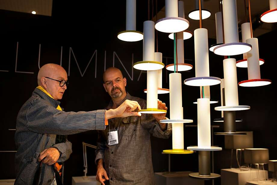 San Francisco designer Orlando Diaz Azcuy discusses the Cielo Suspension Light with Pablo Pardo from San Francisco at the International Contemporary Furniture Fair at the Javits Center in Manhattan, New York on May 20, 2012. Photo: Melanie Burford, Special To The Chronicle