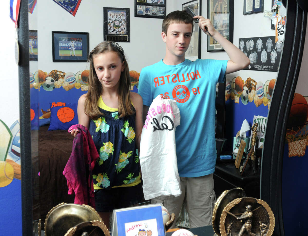 Mackenzie Ward, 11, and her brother Andrew, 13, look in a mirror at their home Tuesday, May 29, 2012 in Albany, N.Y. (Lori Van Buren / Times Union)