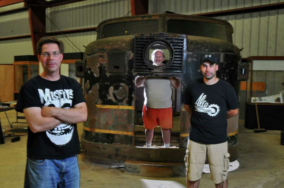 ALCO Heritage Museum Director Jim Cesare, left, stands with an ALCO 5A-1 cap on display in the new musem last month in Schenectady, NY.  The museum officially opened on Sunday, June 10. With Cesare are Kraig Armstrong, volunteer coordinator, center, and Matt Giardino, president, right. (Philip Kamrass / Times Union archive) Photo: Philip Kamrass / 00017722A