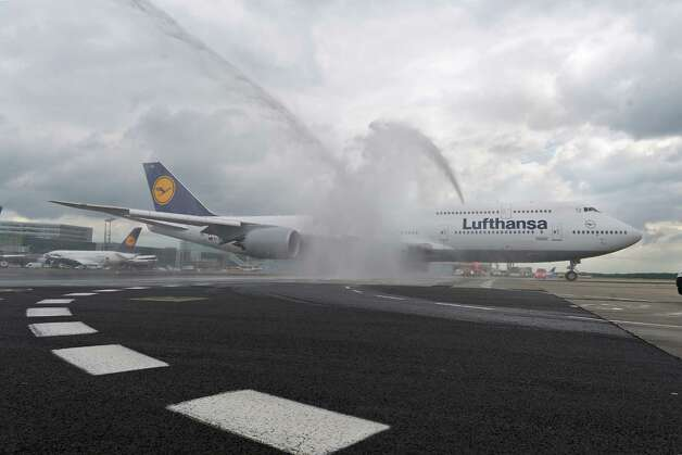 The first Boeing 747-8 Intercontinental for launch airline Lufthansa  gets a traditional firehose salute as it taxis before taking off on its first commercial flight, from Frankfurt,  Germany to  Washington, D.C. on Friday, June 1, 2012. Photo: JUERGEN MAI / JUERGENMAI.COM