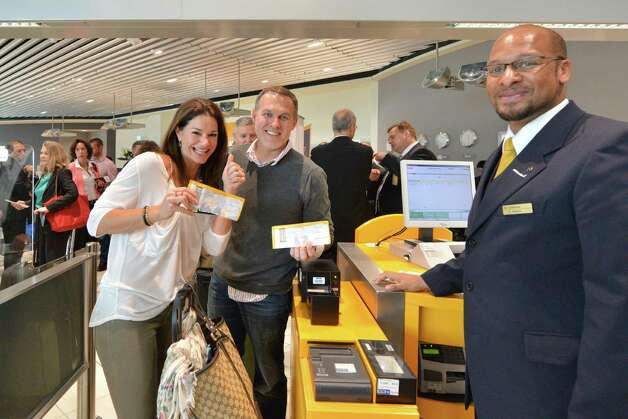 Passengers pose with tickets before boarding the first Boeing 747-8  Intercontinental for launch airline Lufthansa, which made its first commercial flight, from Frankfurt, Germany on Friday, June 1, 2012. Photo: Juergenmai.com / mail@juergenmai.com