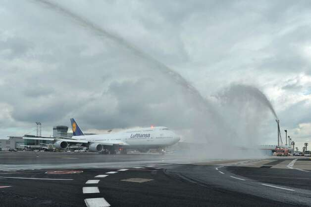 The first Boeing 747-8 Intercontinental for launch airline Lufthansa  gets a traditional firehose salute as it taxis before taking off on its first commercial flight, from Frankfurt,  Germany to  Washington, D.C. on Friday, June 1, 2012. Photo: Juergenmai.com / mail@juergenmai.com