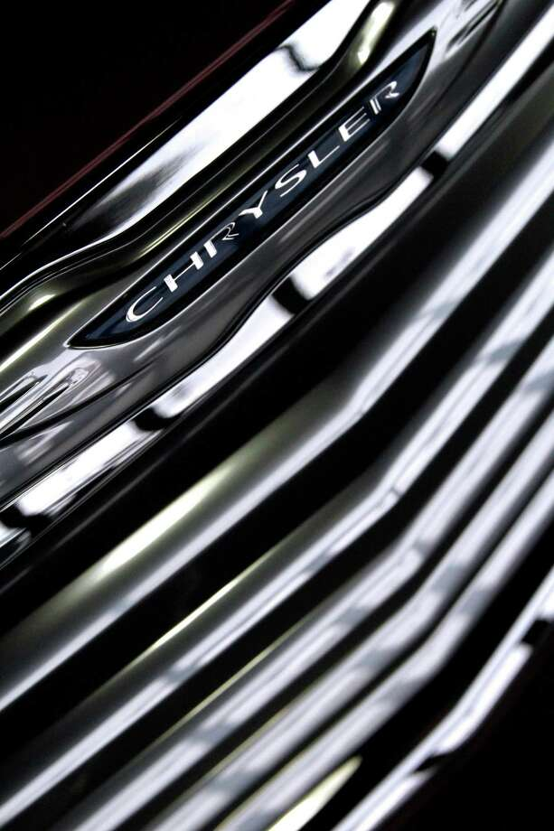 FILE - This Jan. 31, 2012 file photo shows the grill of a 2012 Chrysler 200 displayed on the showroom floor of Goss Dodge Chrysler in South Burlington, Vt. Chrysler says its U.S. sales rose 30 percent and sold more than 150,000 vehicles in May, compared with 115,000 in the same month a year ago (AP Photo/Toby Talbot, file) Photo: Toby Talbot / Copyright 2012 The Associated Press. All rights reserved. This material may not be published, broadcast, rewritten or redistribu