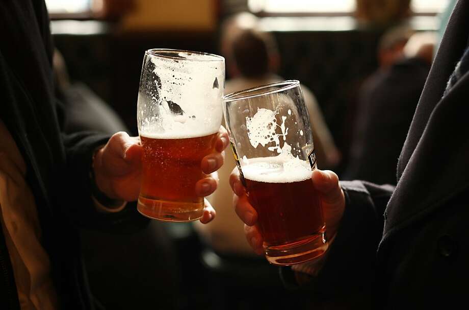 Cheers! Clinking of pint beer glasses Photo: Peter Macdiarmid, Getty Images