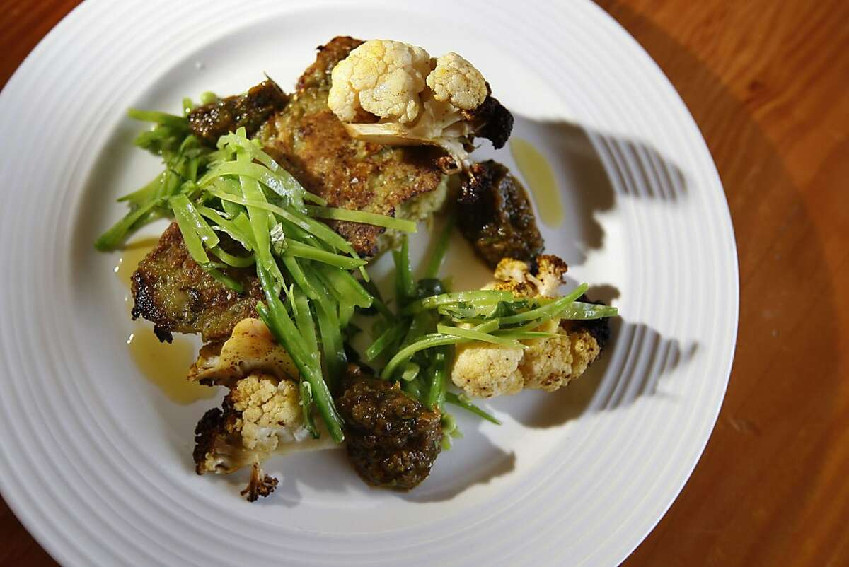 Firefly Restaurant at 4288 24th St in San Francisco offers a Griddled Golden Beet Cake with Spiced Cauliflower, Snow Pea Salad and green Harrissa Saturday, May 19, 2012 in San Francisco Calif.