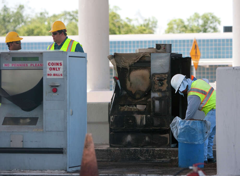 Crews work to clean up an accident after a driver collided with a tollbooth on the Sam Houston Tollway west of S Wayside Drive Friday, June 1, 2012, in Houston. Photo: Cody Duty, Houston Chronicle / © 2011 Houston Chronicle