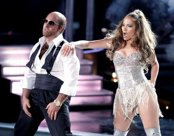 Tom Cruise (L) and Jennifer Lopez perform onstage at the 2010 MTV Movie Awards held at the Gibson Amphitheatre at Universal Studios  on June 6, 2010 in Universal City, California.  (Christopher Polk / Getty Images)