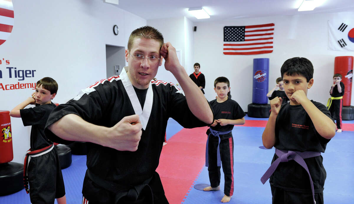 Rob Barghaus, owner-instructor of American Tiger Martial Arts in Brookfield, teaches the Kids Black Belt Club Thursday, June 1, 2012.