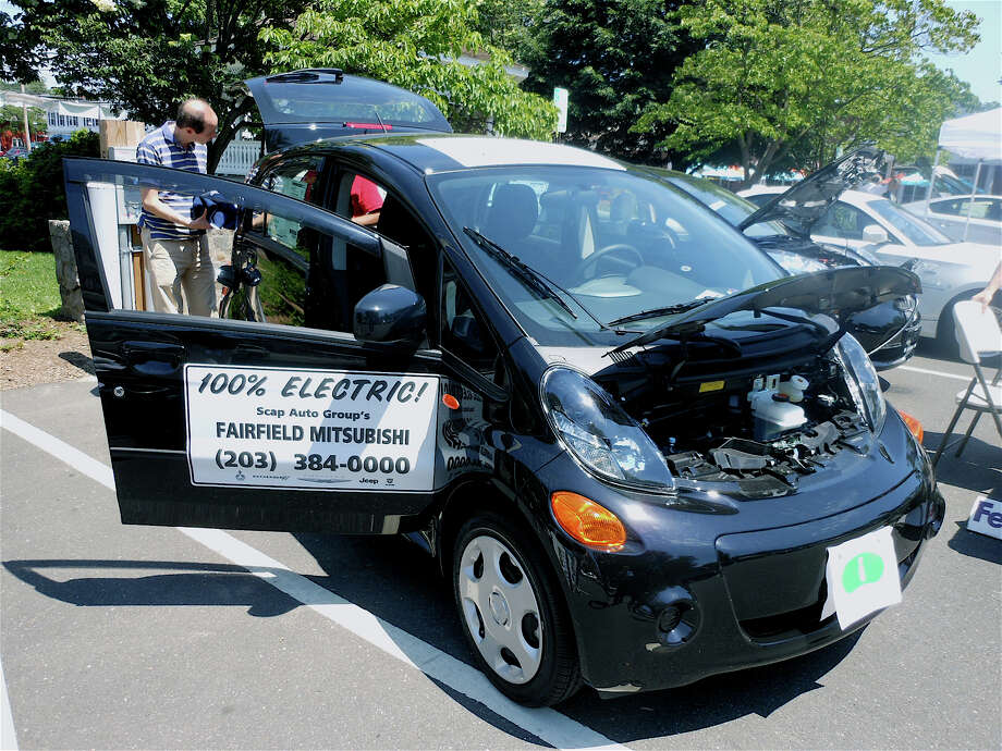 The Mitsubishi iMiEV, a 100 percent electric car, on display at the Electric Car Community Days event at Sherman Green on Friday. Photo: Mike Lauterborn / Fairfield Citizen contributed