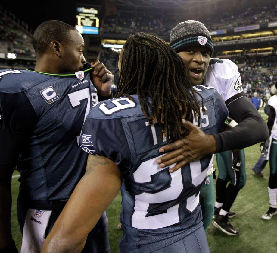 Philadelphia Eagles quarterback Vince Young, right, hugs Seattle Seahawks' Earl Thomas (29), after an NFL football game, Thursday, Dec. 1, 2011, in Seattle. (AP Photo/Ted S. Warren) Photo: (AP Photo/Ted S. Warren), STF / AP