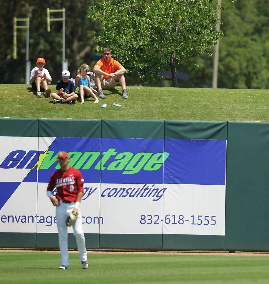 Sam Houston fans sit on the outfield hill in the 6th inning during a college baseball game at the Houston Regional at Rice University, Friday, June 1, 2012, in Houston. Arkansas won the game against Sam Houston 5-4. Photo: Karen Warren, Houston Chronicle / © 2012  Houston Chronicle