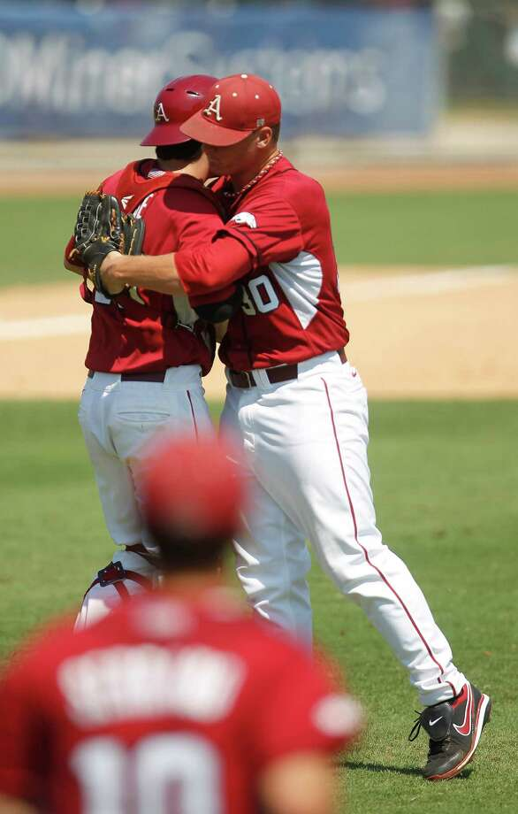 Arkansas' pitcher Brandon Moore (30) and his catcher Jake Wise (19) celebrate their win over Sam Houston 5-4 during a college baseball game at the Houston Regional at Rice University, Friday, June 1, 2012, in Houston. Photo: Karen Warren, Houston Chronicle / © 2012  Houston Chronicle
