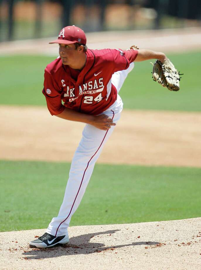 Arkansas starting pitcher DJ Baxendale pitches in the first inning during a college baseball game at the Houston Regional at Rice University, Friday, June 1, 2012, in Houston. Arkansas won the game against Sam Houston 5-4. Photo: Karen Warren, Houston Chronicle / © 2012  Houston Chronicle